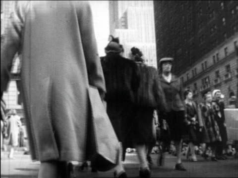 b/w 1945 low angle pedestrians walking past camera on new york city street / educational - 1945 stock videos and b-roll footage