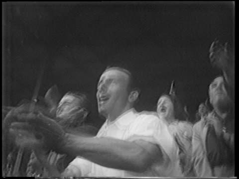 vídeos y material grabado en eventos de stock de b/w 1951 low angle people in audience clapping cheering in stadium / polo grounds / nyc - 1951