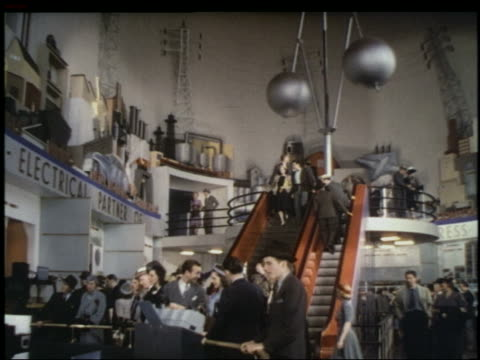 low angle people on stairs + escalator in westinghouse pavilion at ny world's fair - 1939 stock videos & royalty-free footage