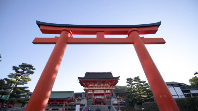 low angle, people outside fushimi inari shrine in kyoto - shrine stock videos & royalty-free footage