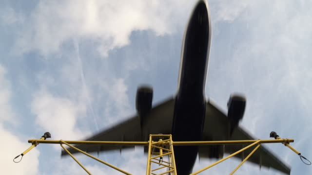 low angle plane coming into land - high up stock videos & royalty-free footage
