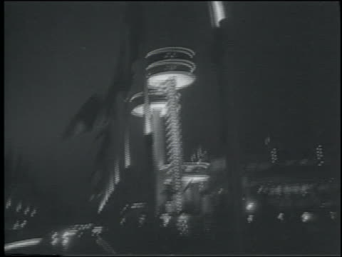 vidéos et rushes de b/w 1964 low angle point of view blowing flags lit towers at night / ny world's fair - exposition universelle de new york