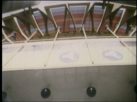 1964 low angle point of view into pavilion with red pink stained glass ceiling at ny world's fair - 1964年点の映像素材/bロール