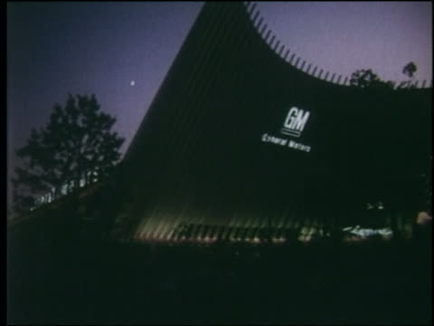vídeos de stock e filmes b-roll de 1964 low angle point of view toward general motors pavilion at dusk / ny world's fair - general motors
