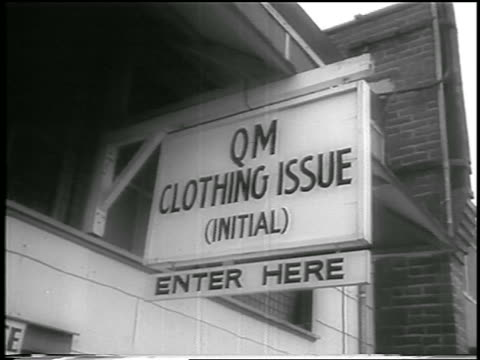b/w 1958 low angle qm clothing issue enter here sign / fort chaffee arkansas / newsreel - 1958 stock videos & royalty-free footage