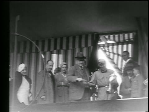 low angle race car driver holding trophy surrounded by people after monaco grand prix - 1933 stock videos & royalty-free footage