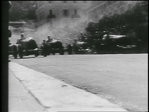 b/w 1933 low angle race cars passing camera in monaco grand prix race / monte carlo - monte carlo stock videos & royalty-free footage