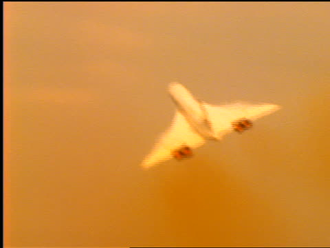 orange low angle rear view pan concorde airliner in flight after take off - british aerospace concorde stock videos and b-roll footage