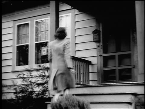 B/W 1943/44 low angle REAR VIEW woman walks up stairs to porch + enters house / Springfield, NJ