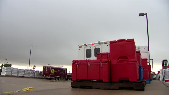 low angle red cross truck driving by containers of hot meals - american red cross stock videos & royalty-free footage