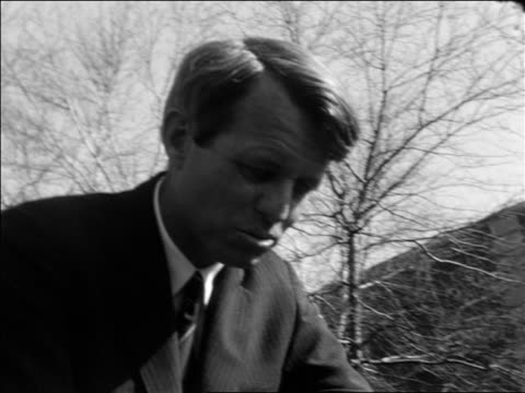 vídeos y material grabado en eventos de stock de b/w 1968 low angle pan robert kennedy on car moving thru crowd shaking hands during campaign / documentary - senador