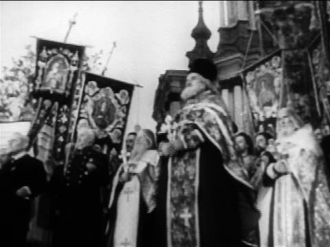 b/w 1904 low angle russian orthodox priest performing ceremony outdoors / documentary - priest stock videos and b-roll footage