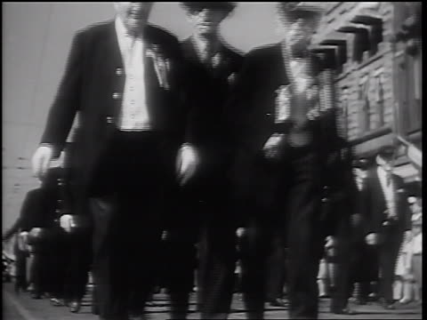 b/w 1932 low angle senior male civil war veterans walking in parade / springfield il - 1932 stock videos & royalty-free footage