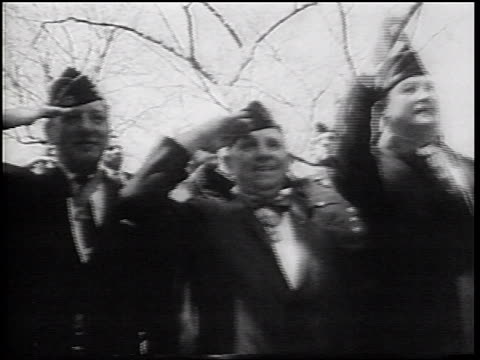 low angle senior war veterans in hats saluting at pro-vietnam war demonstration / nyc - war veteran stock videos & royalty-free footage