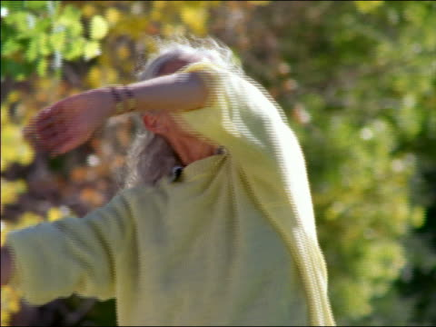 low angle senior woman doing yoga type exercises - only senior women stock videos & royalty-free footage