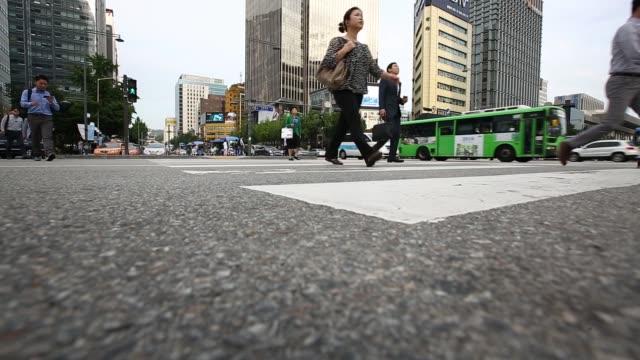 low angle shot feet of morning commuters and pedestrians walking through gwanghwamun square in seoul south korea on friday aug 28 wide shot morning... - gehaltsstreifen stock-videos und b-roll-filmmaterial