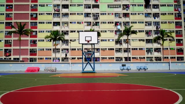 low angle shot in front of a colourful apartment block in the choi hung estate, hong kong - block shape stock videos & royalty-free footage