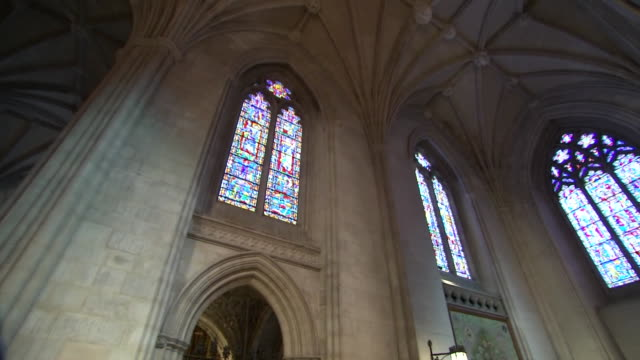 low angle shot looking up at the vaulted ceilings and stained glass windows inside of the washington national cathedral on september 31, 2018. - religion or spirituality stock videos & royalty-free footage