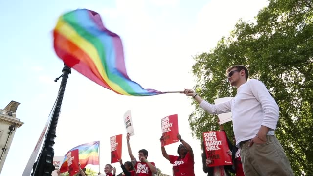Low angle shot man waving a gay pride flag Gay Marriage Bill Debated on June 03 2013 in London England