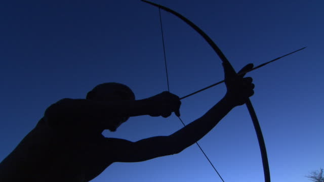 low angle shot of a man using a bow and arrow - bow and arrow stock videos and b-roll footage