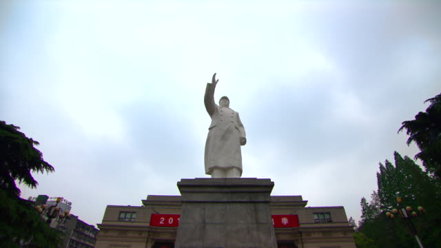 Low angle shot of a statue of Chairman Mao in the city of Wuhan.