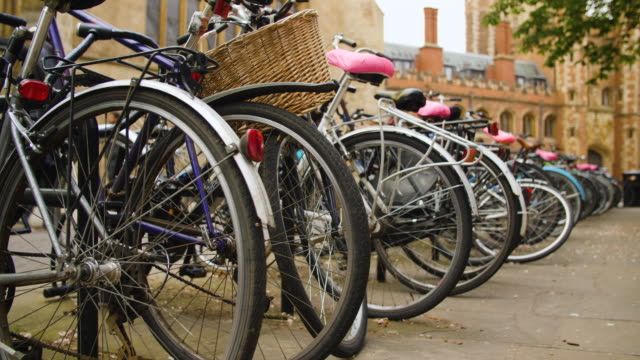 low angle shot of bicycle racks near trinity college, cambridge. - cambridge england stock videos and b-roll footage