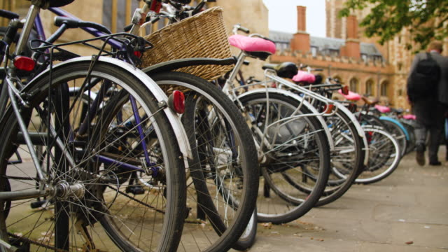 low angle shot of bicycle racks near trinity college, cambridge. - イングランド ケンブリッジ点の映像素材/bロール