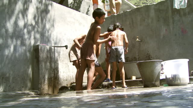 Low angle shot of boys washing