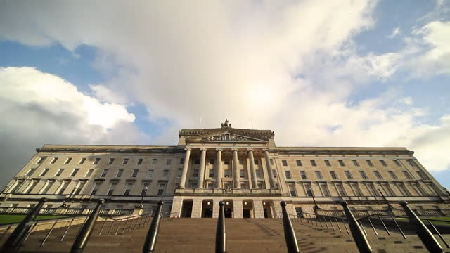"""low angle shot of exterior of northern ireland parliament building, stormont, with timelapse clouds - """"bbc news"""" stock videos & royalty-free footage"""