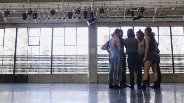 low angle shot of female choreographer explaining dance moves to dance troupe with tablet - dance studio stock videos & royalty-free footage