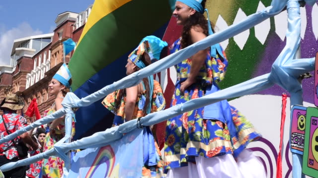 a low angle shot of female dancers performing on a parade float in the brighton gay pride parade 2017 - festivalsflotte bildbanksvideor och videomaterial från bakom kulisserna