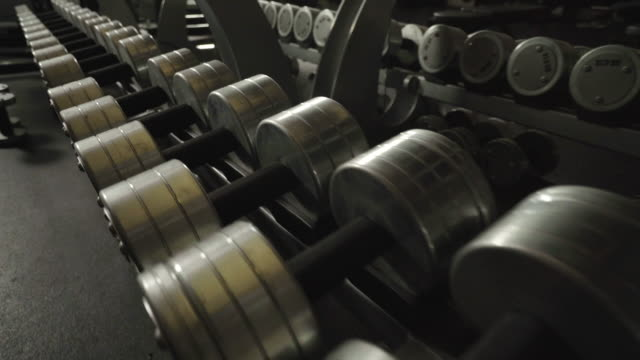 Low angle shot of free weights inside gym