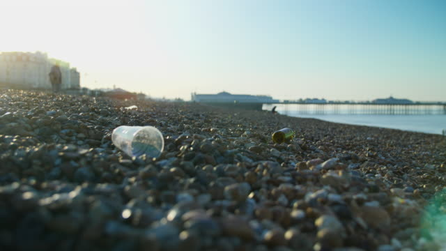 low angle shot of litter on brighton beach. - brighton brighton and hove stock-videos und b-roll-filmmaterial