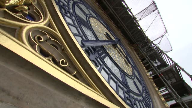 low angle shot of newly restored clock face of big ben - 角度点の映像素材/bロール