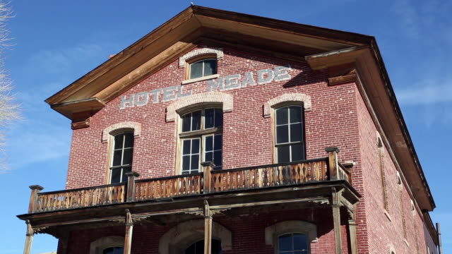 low angle shot of old abandoned brick hotel in ghost town of bannack, mt.. - hotel stock videos & royalty-free footage