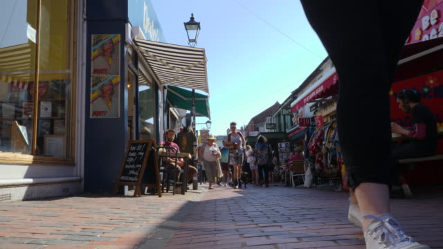low angle shot of people browsing the many shops in brighton's famous north lanes. - surface level stock videos & royalty-free footage