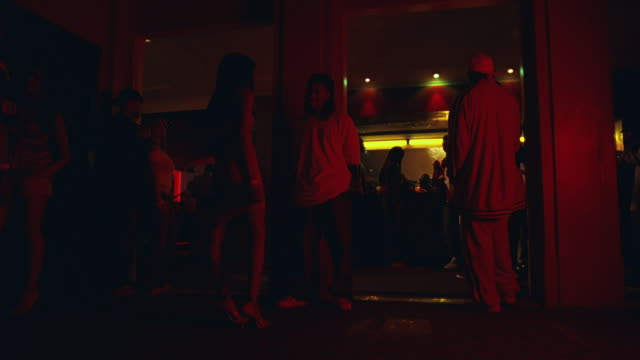 low angle shot of people entering a bar. - lobby stock videos & royalty-free footage
