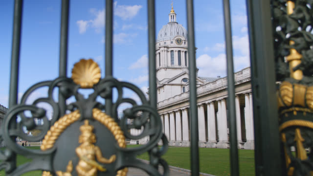 low angle shot of queen mary court at the old royal naval college through black gated entrance in greenwich - queen royal person stock videos and b-roll footage