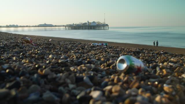 Low angle shot of rubbish strewn across Brighton Beach