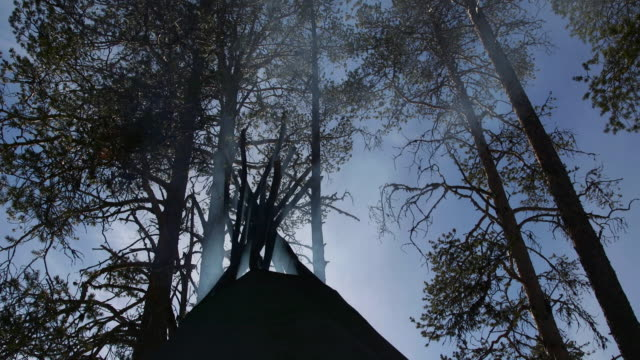 low angle shot of smoke billowing out of a saami tent. - finland stock videos & royalty-free footage