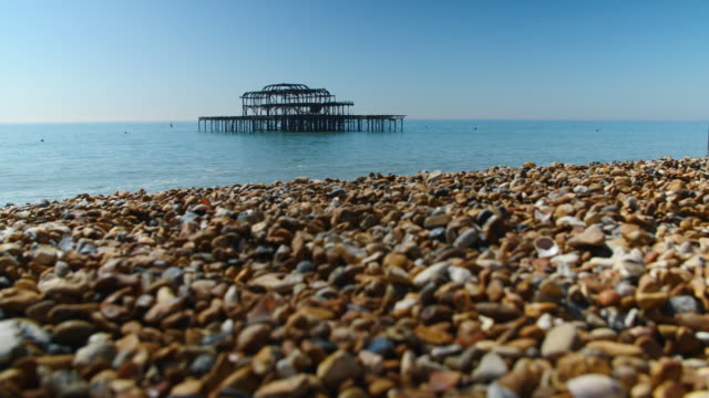 low angle shot of the derelict west pier at brighton beach. - pebble stock videos & royalty-free footage