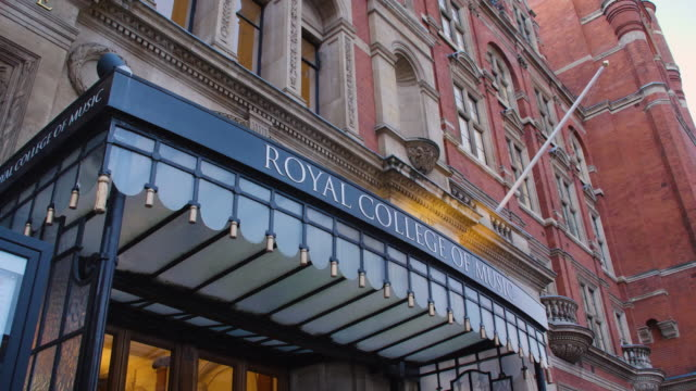 low angle shot of the entrance sign to the royal college of music in central london. - entrance sign stock videos & royalty-free footage