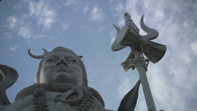 low angle shot of the statue of shiva in the city of hardiwar.  - god stock videos & royalty-free footage