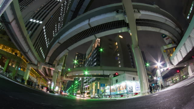t/l, low angle shot of traffic in tokyo at night. - wide angle stock videos & royalty-free footage