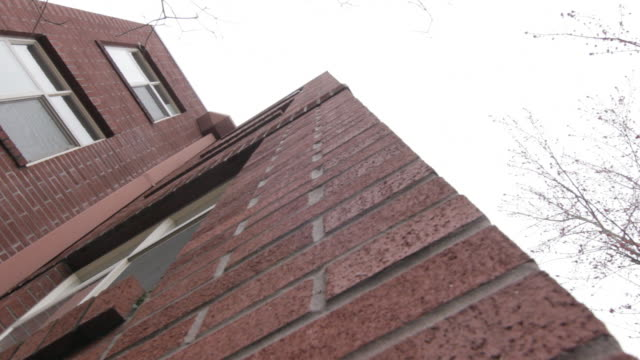 Low angle shot of two storey brick building