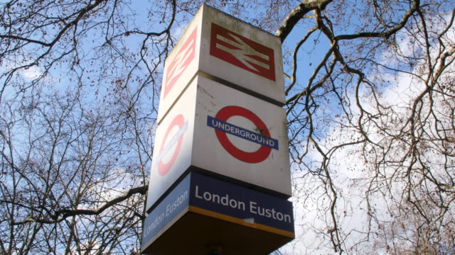 stockvideo's en b-roll-footage met low angle shot on a sign for london euston's rail and underground stations. - establishing shot