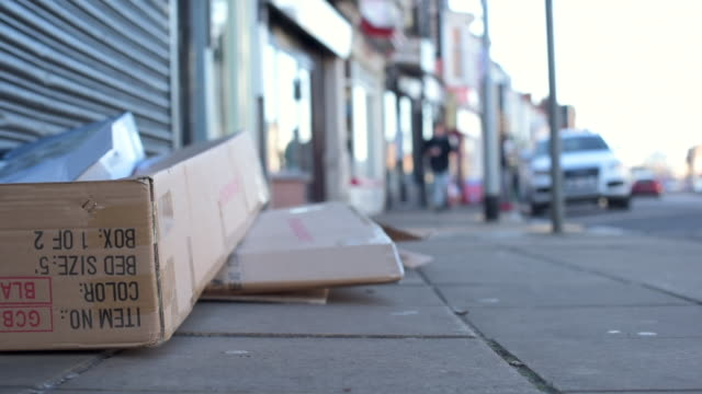 low angle shot showing a pile of various cardboard boxes that have been left in the streets of northampton. - northampton stock-videos und b-roll-filmmaterial