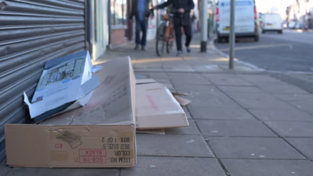 low angle shot showing cardboard boxes that have been left in the streets of northampton. - northampton stock-videos und b-roll-filmmaterial