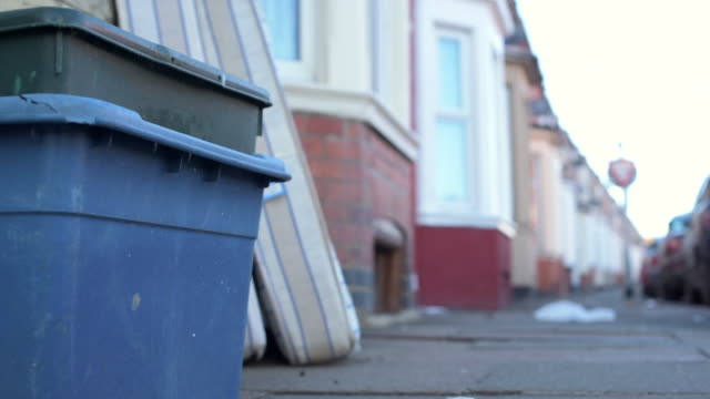 low angle shot showing recycling boxes and mattresses that have been left in the streets of northampton. - northampton stock-videos und b-roll-filmmaterial