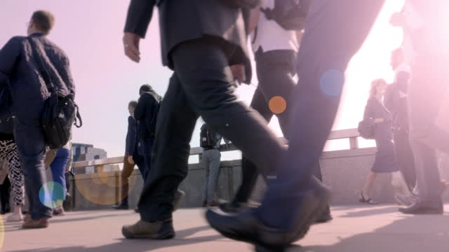 low angle side view of commuters walking to work. - incidental people stock videos & royalty-free footage